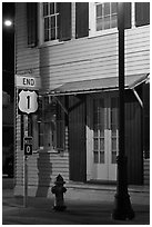 Sign marking end of US route 1. Key West, Florida, USA ( black and white)