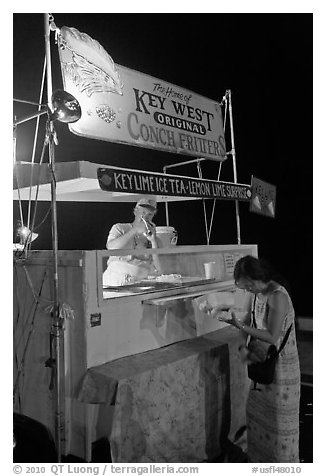 Food stall selling conch fritters on Mallory Square. Key West, Florida, USA (black and white)