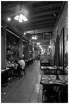 Cuban restaurant at night, Mallory Square. Key West, Florida, USA ( black and white)