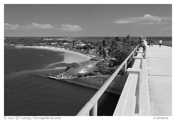 Tourists observing view from old bridge, Bahia Honda Key. The Keys, Florida, USA (black and white)