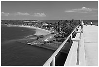 Tourists observing view from old bridge, Bahia Honda Key. The Keys, Florida, USA ( black and white)