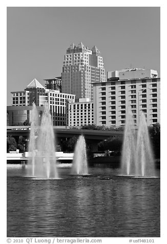 Fountains and downtown high-rises from Lake Lucerne. Orlando, Florida, USA (black and white)