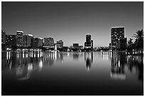 City skyline at dusk from Sumerlin Park. Orlando, Florida, USA (black and white)