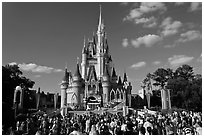 Iconic Cindarella Castle with tourists gathered for show, Magic Kingdom. Orlando, Florida, USA (black and white)