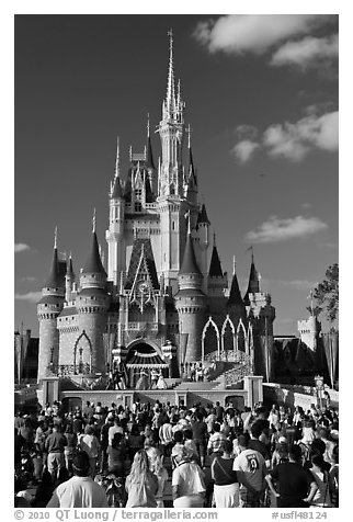 Tourists attend stage musical in front of Cindarella castle. Orlando, Florida, USA (black and white)