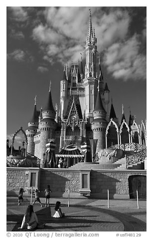 Girls in front of Cindarella castle, Walt Disney World. Orlando, Florida, USA (black and white)