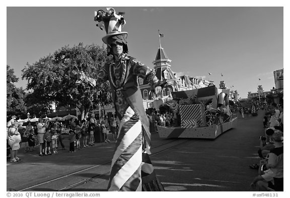 Character on stilts during parade, Main Street. Orlando, Florida, USA (black and white)