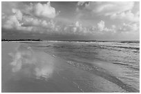 Sky reflecting in wet sand, Fort De Soto beach. Florida, USA ( black and white)
