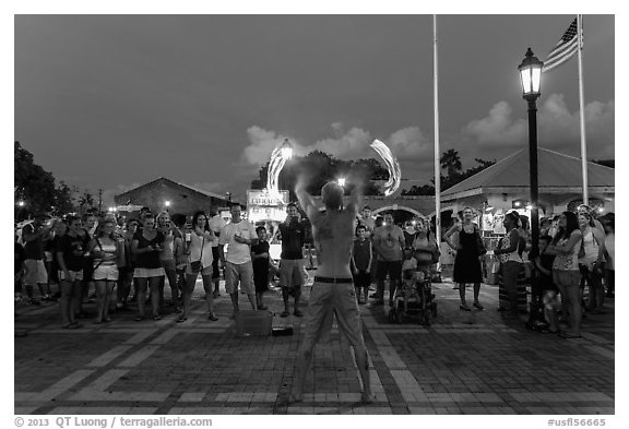 Street entertainer and spectators. Key West, Florida, USA (black and white)