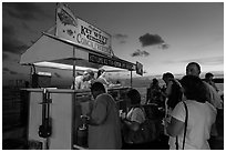 People buying food at stand on Mallory Square. Key West, Florida, USA ( black and white)