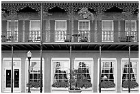 Balcony with wrought-iron decor, Marshall House, Savannah oldest hotel. Savannah, Georgia, USA ( black and white)