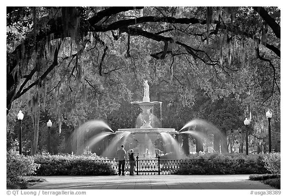 Fountain in Forsyth Park with couple standing. Savannah, Georgia, USA