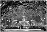 Fountain in Forsyth Park with couple standing. Savannah, Georgia, USA (black and white)
