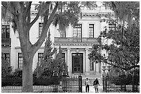 Women walking out of mansion. Savannah, Georgia, USA (black and white)