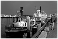 Ferry and riverboat on Savannah River at dusk. Savannah, Georgia, USA (black and white)