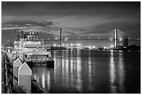 Riverboat and Savannah Bridge at dusk. Savannah, Georgia, USA (black and white)