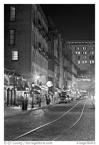 Rails and Cobblestone street by night. Savannah, Georgia, USA (black and white)
