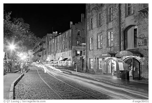 Car lights on River Street by night. Savannah, Georgia, USA (black and white)