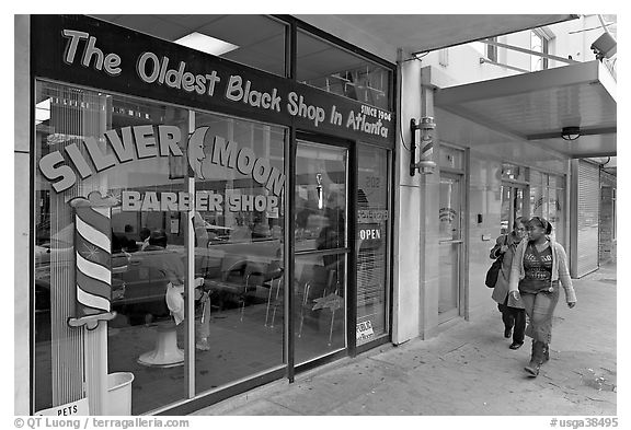 Women walking in front of oldest black shop in Atlanta. Atlanta, Georgia, USA