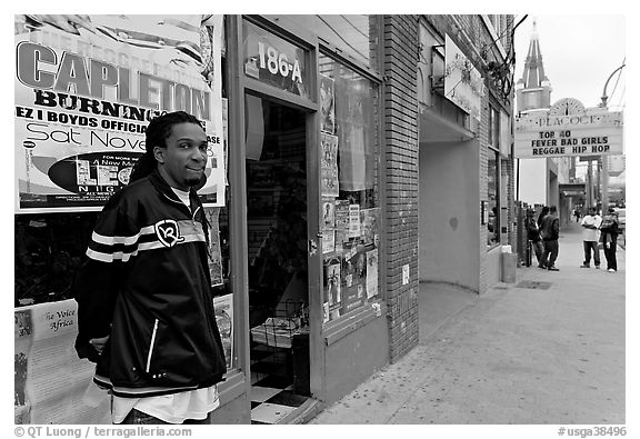 Man standing in front of music store, sweet Auburn. Atlanta, Georgia, USA