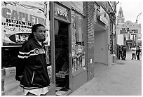 Man standing in front of music store, sweet Auburn. Atlanta, Georgia, USA (black and white)