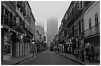 Bourbon street and the new town in the fog, French Quarter. New Orleans, Louisiana, USA (black and white)