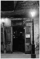 Cafe on Bourbon street at night, French Quarter. New Orleans, Louisiana, USA ( black and white)