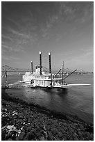 Riverboat, Mississippi River, and bridge, morning. Natchez, Mississippi, USA (black and white)