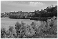Banks of the Mississippi River with small boat. Natchez, Mississippi, USA (black and white)