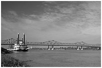 Mississippi River, paddle steamer, and bridge. Natchez, Mississippi, USA (black and white)