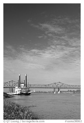 Mississippi River, paddle riverboat, and bridge. Natchez, Mississippi, USA (black and white)