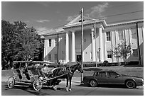 Horse carriage in front of the courthouse. Natchez, Mississippi, USA ( black and white)
