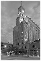 Art Deco building with clock tower at dusk. Jackson, Mississippi, USA (black and white)