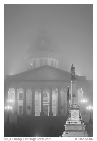 Monument and state capitol in fog at night. Columbia, South Carolina, USA (black and white)
