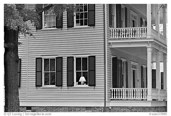 House with lamp inside window. Columbia, South Carolina, USA (black and white)