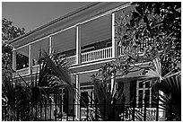 Facade of house with balconies and columns. Charleston, South Carolina, USA (black and white)
