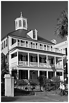 Couple walking in front of antebellum house. Charleston, South Carolina, USA ( black and white)