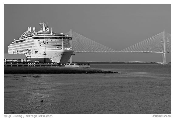 Cruise ship and suspension bridge of Cooper River. Charleston, South Carolina, USA (black and white)