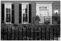 House facade at dusk with roses in front yard. Charleston, South Carolina, USA ( black and white)