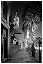St Michael Episcopal Church, sidewalk, and palm trees at night. Charleston, South Carolina, USA ( black and white)