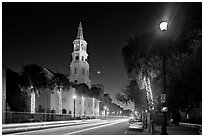 St Michael Episcopal Church and street with traffic at night. Charleston, South Carolina, USA ( black and white)