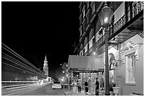 Street, church, and Mills house hotel with many guests at night. Charleston, South Carolina, USA ( black and white)