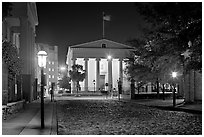 Street with cobblestone pavement at night. Charleston, South Carolina, USA ( black and white)
