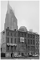 Row of brick buildings and Bell South Tower in fog. Nashville, Tennessee, USA (black and white)