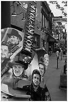 Guitar-shaped sign with images of famous singers on Broadway sidewalk. Nashville, Tennessee, USA ( black and white)