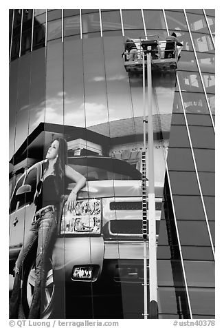 Workers pasting mural-sized car advertising on building. Nashville, Tennessee, USA (black and white)