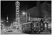 Street by night with trolley and Orpheum theater. Memphis, Tennessee, USA ( black and white)