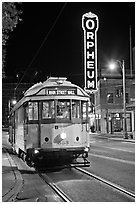 Trolley and Orpheum theater sign by night. Memphis, Tennessee, USA (black and white)
