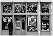 African-American man standing in front of blue storefront on Beal street. Memphis, Tennessee, USA (black and white)