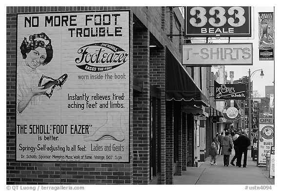 Old advertising on brick building and sidewalk, Beale street. Memphis, Tennessee, USA (black and white)